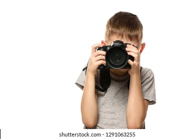 Boy takes pictures on the camera. Portrait. Isolate on white background.