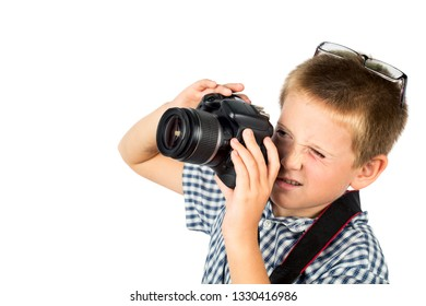 Boy takes pictures on the camera. Portrait. Isolate on white background. Side view