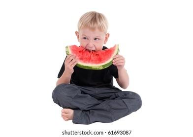 Boy taking a bite from a juicy watermelon
