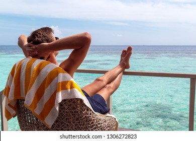 boy taking a sunbath in the maldives. holiday in paradise concept