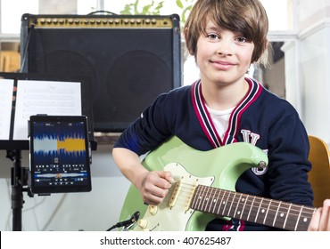 Boy talking guitar lessons
