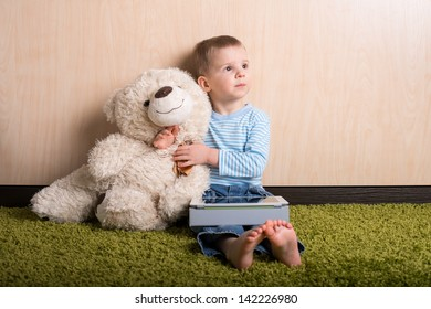 Boy and teddy bear with tablet computer, dreamy