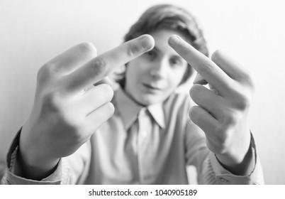 Boy teen gives middle finger