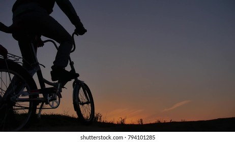 The boy teen and man is riding a bicycle. Travel silhouette sunset sunrise sunlight traveler