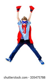 A boy teenager in a costume of superhero in jumping. Isolated over white background.