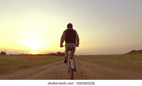 Boy teenager riding a bicycle. Boy teenager riding a bicycle goes to nature along the path