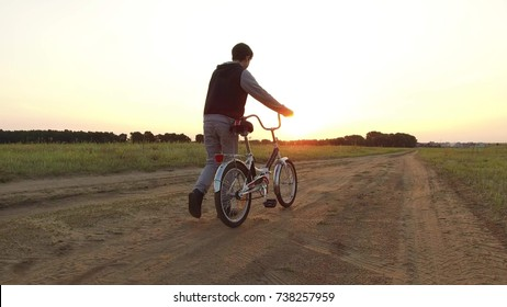 Boy teenager riding a bicycle. Boy teenager riding bicycle goes nature along the path steadicam shot motion video