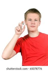 The boy, the teenager spraying fragrance perfume