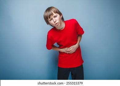 Boy teenager twelve years in the red shirt abdominal pain, gastritis, diarrhea