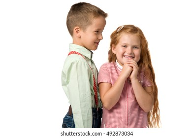 boy telling a secret to a girl. Girl surprised