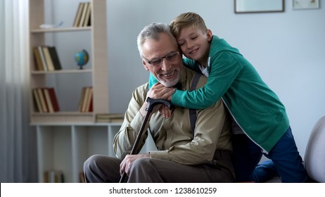 Boy tenderly embracing grandfather, family love, respect for older generation