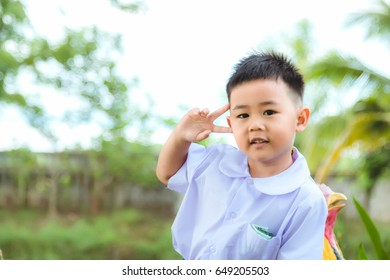 The boy in Thai student uniform for go to school