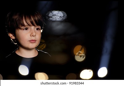 boy thinking and looking at window over lights