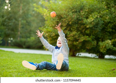 Boy throws with peach