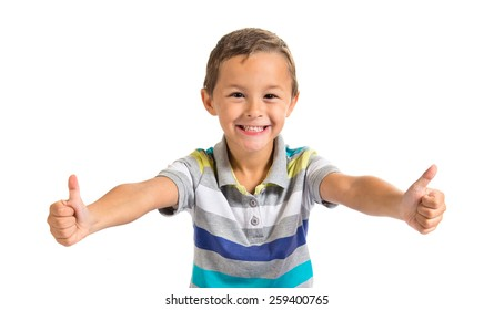 Boy with thumb up over white background