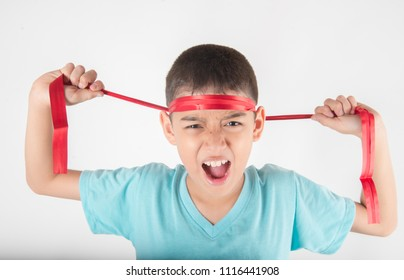 Boy tie a bow on his head  intend to cheering up for sport