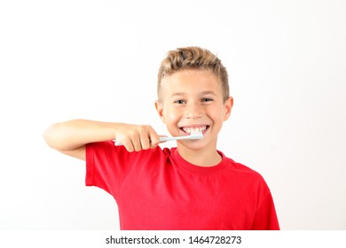 Boy with toothbrush on white background, space for text