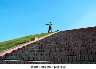 boy in top of a stairs with open arms - symbol of freedom