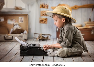 Boy tourist typing a letter on a typewriter in his room