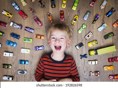 Boy with toy cars