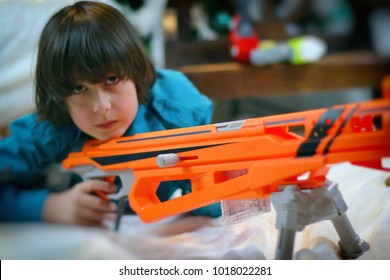 Boy with a toy weapon.
