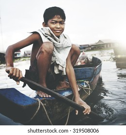 Boy Traveling by Boat in Floating Village Concept