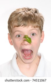 boy with tree on frog face white high key background