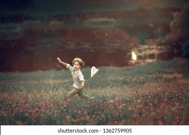 A boy is truing to catch a butterfly with his net. Image with selective focus and toning.