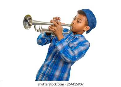 Boy trumpeter performs on stage. Famed musician plays solo on trumpet.