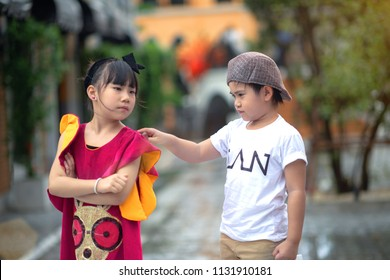 boy try to reconcile a girl to make new friend again, to forgiveness after conflicted and upset of the girl