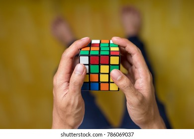A boy trying to solving the 4 by 4 rubic cube