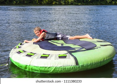 Boy tubing on an inland lake