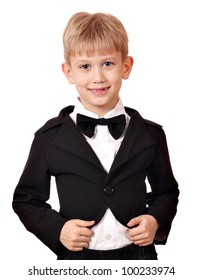 boy with tuxedo and bow tie posing