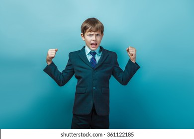 a boy of  twelve European appearance  in a suit shouting angry o
