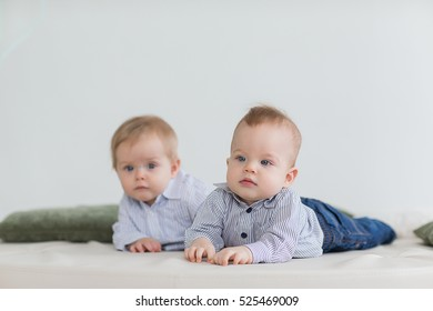 boy twins playing on the floor