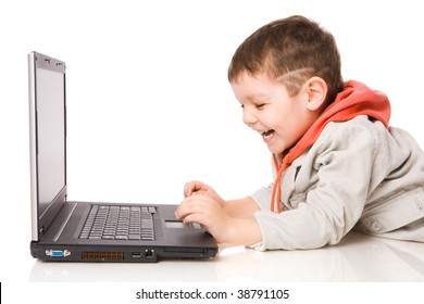 Boy typing on laptop and laughing isolated on white