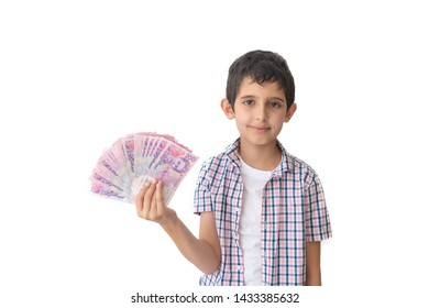 The boy with ukrainian money hryvnia in hands on a white background. Teenager