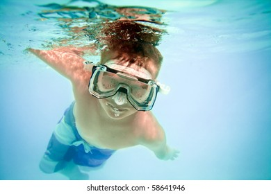 boy under water in pool