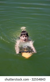 boy with  underwater scooter in the green water