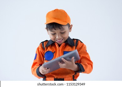 A boy uniform as a astronout on white background
