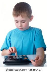 Boy using a calculator for his homework