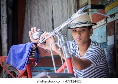 boy and vintage bicycle