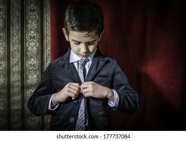 Boy in vintage black suit and tie