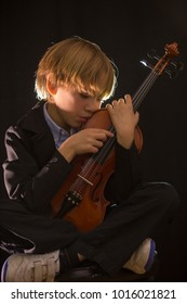 boy with violin in various poses, happy, thoughtful, bored, enjoying in black background