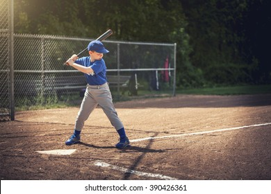 Boy waiting for the ball in a baseball game
