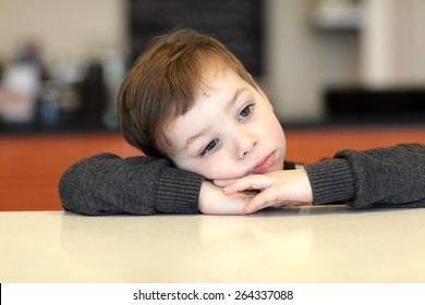 Boy waiting for dessert in the cafe