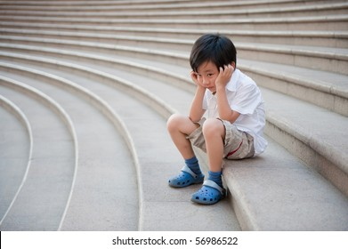 Boy waiting endlessly on the stairs