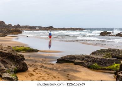 Boy Walking on a Solitary Beach in Fuerteventura, Canary Islands