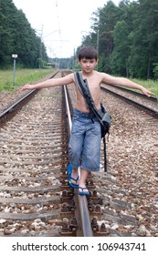 A boy walking on the tracks