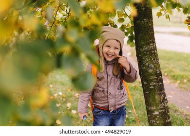 boy walks in autumn park